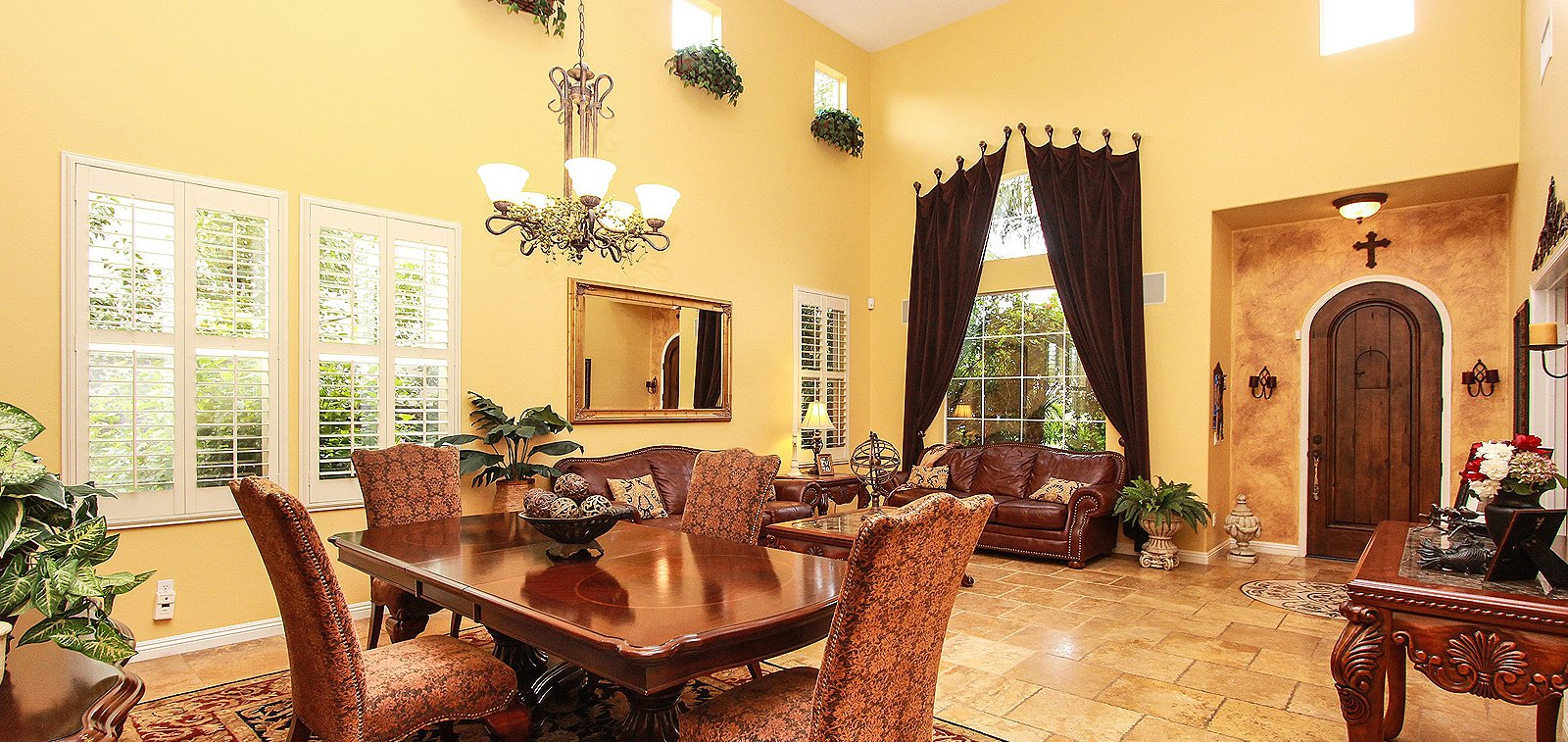 THE HENSLEY GROUP REAL ESTATE - well lit dining and living room w/ high ceiling and chandelier